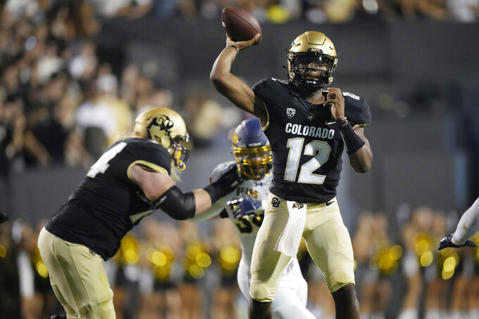 Colorado quarterback Brendon Lewis throws a pass against Northern Colorado in the first half of an NCAA college football game Friday, Sept. 3, 2021, in Boulder, Colo. (AP Photo/David Zalubowski)