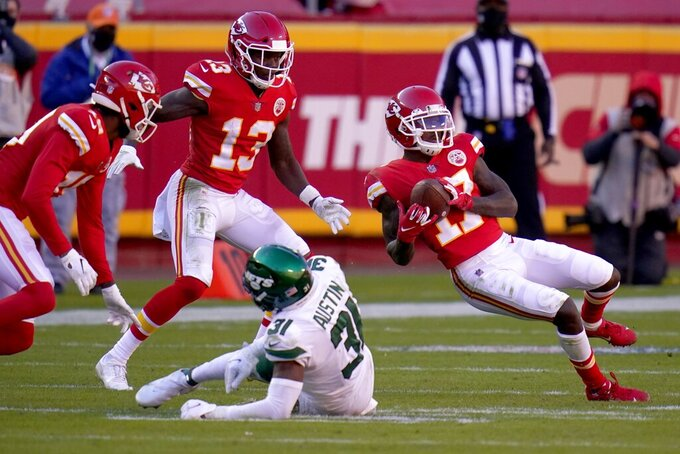 Kansas City Chiefs wide receiver Mecole Hardman (17) catches a pass over New York Jets cornerback Bless Austin (31) as wide receiver Byron Pringle (13) looks on in the second half of an NFL football game on Sunday, Nov. 1, 2020, in Kansas City, Mo. (AP Photo/Jeff Roberson)