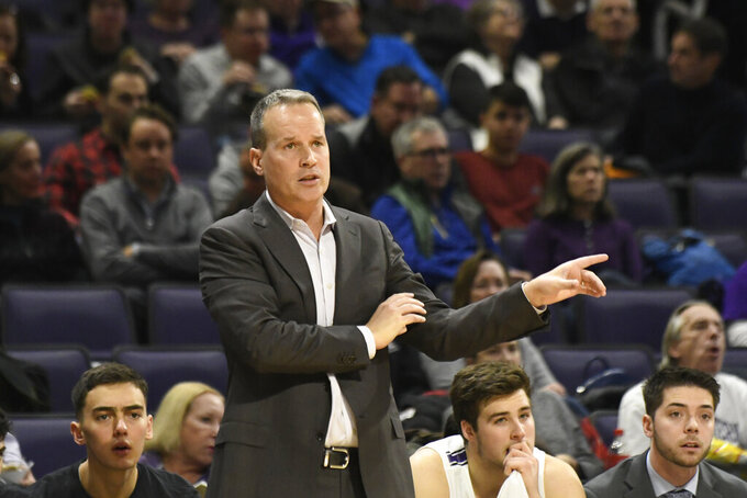 Northwestern head coach Chris Collins gestures to his team during the first half of an NCAA college basketball game against Maryland, Tuesday, Jan. 21, 2020, in Evanston, Ill. (AP Photo/David Banks)