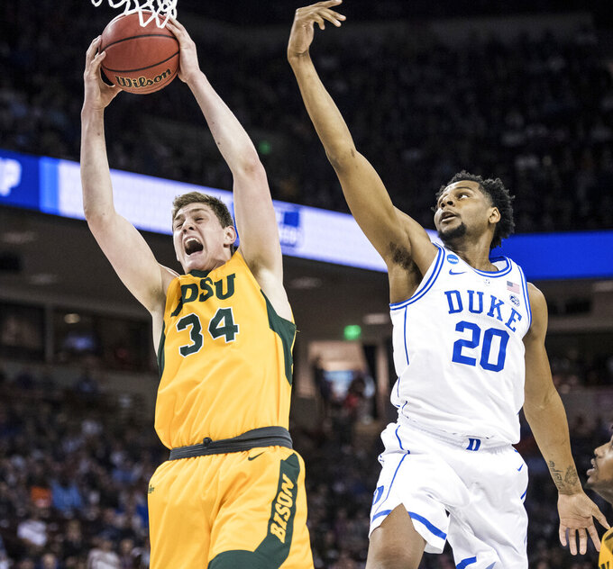 North Dakota State forward Rocky Kreuser (34) grabs a rebound next to Duke center Marques Bolden (20) during the first half of a first-round game in the NCAA men's college basketball tournament Friday, March 22, 2019, in Columbia, S.C. (AP Photo/Sean Rayford)