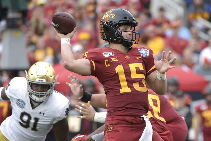 FILE - In this Dec. 28, 2019, file photo, Iowa State quarterback Brock Purdy (15) throws a pass in front of Notre Dame defensive lineman Adetokunbo Ogundeji (91) during the first half of the Camping World Bowl NCAA college football game, in Orlando, Fla. Purdy, who led the most productive offense in program history, has the look of a high-round pick if he declares for the NFL draft after his junior year. (AP Photo/Phelan M. Ebenhack, File)