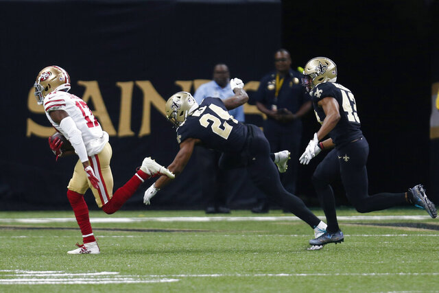 San Francisco 49ers wide receiver Emmanuel Sanders (17) carries on a touchdown reception as New Orleans Saints free safety Marcus Williams (43) and defensive back K'Waun Williams (24) pursue in the first half an NFL football game in New Orleans, Sunday, Dec. 8, 2019. (AP Photo/Butch Dill)