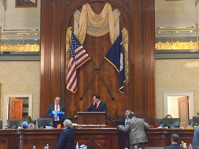 The South Carolina House of Representatives, led by House Speaker Jay Lucas, gavels in to the start of a two-week-long special session, Tuesday, Sept. 15, 2020, in Columbia, S.C. The House debated legislation to expand voting access ahead of the November election. (AP Photo/Michelle Liu)