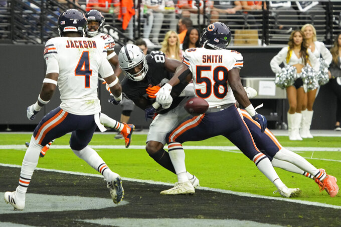 Chicago Bears inside linebacker Roquan Smith (58) helps break up a pass intended for Las Vegas Raiders wide receiver Bryan Edwards (89) during the first half of an NFL football game, Sunday, Oct. 10, 2021, in Las Vegas. (AP Photo/Rick Scuteri)