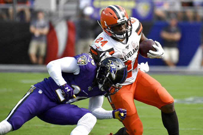 Cleveland Browns running back Nick Chubb (24) is tackled by Baltimore Ravens cornerback Maurice Canady (26) during the first half of an NFL football game Sunday, Sept. 29, 2019, in Baltimore. (AP Photo/Brien Aho)