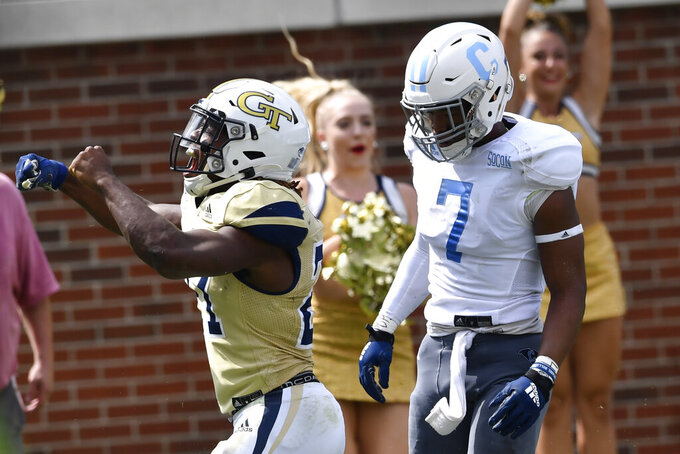 Georgia Tech running back Jordan Mason, left, celebrates a touchdown against The Citadel during the second half of an NCAA college football game, Saturday, Sept. 14, 2019, in Atlanta. The Citadel won 27-24 in overtime. (AP Photo/Mike Stewart)