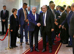 Iraqi Foreign Minister Mohamed Alhakim, center left, shakes hands with his visiting French counterpart Jean-Yves Le Drian, center right, at the Ministry of Foreign Affairs in Baghdad, Iraq, Thursday, Oct. 17, 2019. (AP Photo/Khalid Mohammed)