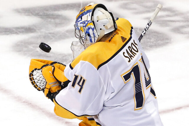 Nashville Predators goaltender Juuse Saros (74) makes a save during the third period of an NHL hockey game against the New York Rangers, Monday, Dec. 16, 2019, in New York. The Predators defeated the Rangers 5-2. (AP Photo/Kathy Willens)