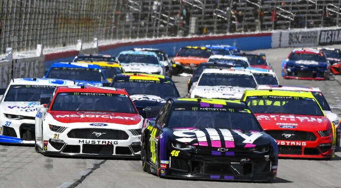 Driver Jimmie Johnson (48) leads the field during a NASCAR Cup auto race at Texas Motor Speedway, Sunday, March 31, 2019, in Fort Worth, Texas. (AP Photo/Larry Papke)