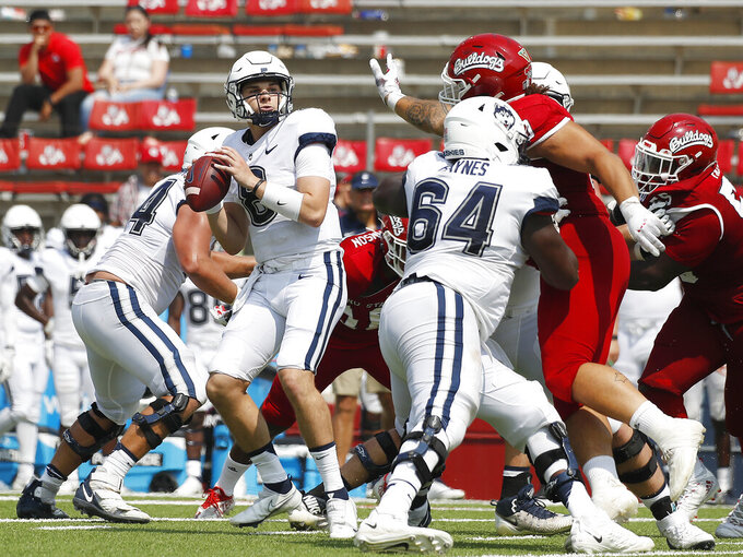 Connecticut quaterback Steven Krajewski looks to pass against Fresno State during the second half of an NCAA college football game in Fresno, Calif., Saturday, Aug. 28, 2021. (AP Photo/Gary Kazanjian)