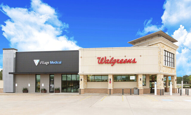This June 2020 photo provided by VillageMD shows a Walgreens with an adjoining VillageMD in Houston. Walgreens will squeeze the primary care clinics into as many as 700 of its U.S. stores over the next few years in a major expansion of the care it offers customers. The drugstore chain said Wednesday, July 8 that it will partner with VillageMD to set up doctor-led clinics that also use nurses, social workers and therapists to provide regular treatment for patients. (VillageMD via AP)