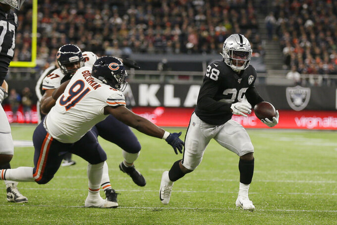 Oakland Raiders running back Josh Jacobs (28) runs past Chicago Bears nose tackle Eddie Goldman (91) for a touchdown during the first half of an NFL football game at Tottenham Hotspur Stadium, Sunday, Oct. 6, 2019, in London. (AP Photo/Tim Ireland)