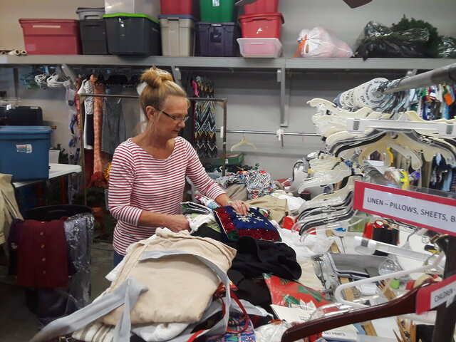 In this undated photo, volunteer worker Wanda Percle sorts donations at Gym Dandy, Thibodaux, La.'s oldest thrift store.  (Dan Copp/The Houma Courier via AP)