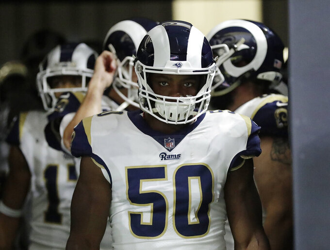 Los Angeles Rams' Samson Ebukam waits to run on the field before the NFL football NFC championship game against the New Orleans Saints, Sunday, Jan. 20, 2019, in New Orleans. (AP Photo/David J. Phillip)