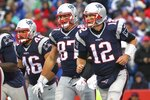 "FILE - In this Oct. 30, 2016, file photo, New England Patriots' Tom Brady (12), Rob Gronkowski (87) and James Develin (46) head back to the sideline after LeGarrette Blount scored a touchdown during the second half of the team's NFL football game against the Buffalo Bills in Orchard Park, N.Y. Gronkowski says he is retiring from the NFL after nine seasons. Gronkowski announced his decision via a post on Instagram Sunday, March 24, 2019, saying that a few months shy of this 30th birthday ""its time to move forward and move forward with a big smile."" (AP Photo/Bill Wippert, File)"