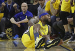 Golden State Warriors center DeMarcus Cousins reacts after falling to the floor during the first half of Game 2 of a first-round NBA basketball playoff series against the Los Angeles Clippers in Oakland, Calif., Monday, April 15, 2019. (AP Photo/Jeff Chiu)