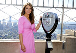 FILE - In this Oct. 1, 2012 file photo, spokesperson and model Elizabeth Hurley poses on the observation deck after lighting the Empire State Building pink in honor of the 20th Anniversary of the Estee Lauder Companies' Breast Cancer Awareness Campaign in New York. Hurley turns 55 on June 10. (Photo by Evan Agostini/Invision/AP, File)