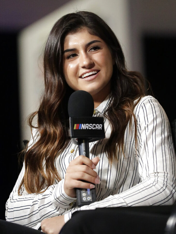 NASCAR driver Hailie Deegan takes part in an interview during Daytona 500 auto racing media day at Daytona International Speedway, Wednesday, Feb. 13, 2019, in Daytona Beach, Fla. (AP Photo/John Raoux)
