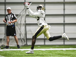 New Orleans Saints wide receiver Juwan Johnson makes a catch during an NFL football training camp practice in New Orleans, Saturday, Aug. 21, 2021. (Max Becherer/The Advocate via AP)