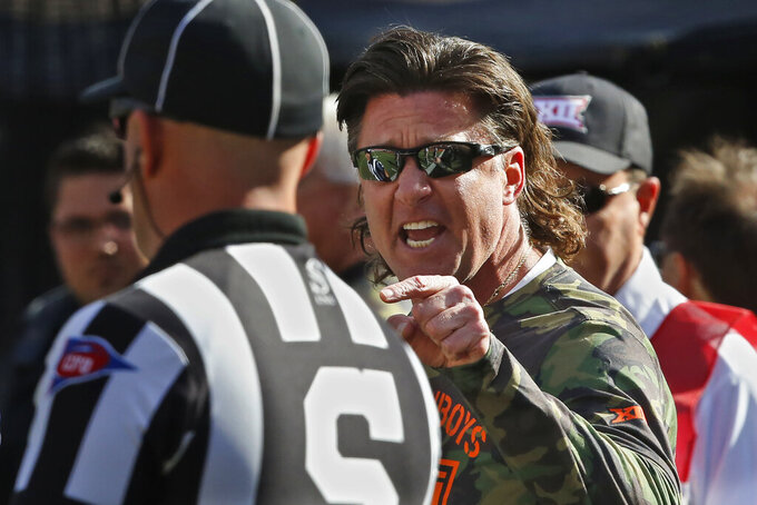 Oklahoma State head coach Mike Gundy complains to an official in the first half of an NCAA college football game against Kansas in Stillwater, Okla., Saturday, Nov. 16, 2019. (AP Photo/Sue Ogrocki)