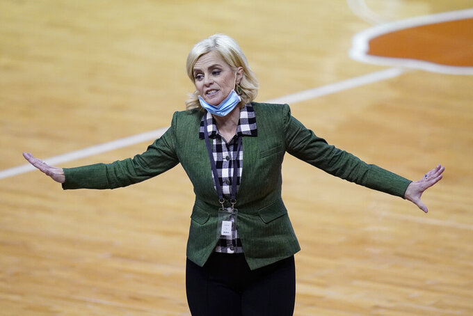 FILE - Baylor head coach Kim Mulkey gestures during the second half of an NCAA college basketball game against Texas in Austin, Texas, in this Monday, March 1, 2021, file photo. Baylor coach Kim Mulkey is no advocate for playing conference tournaments, especially after winning the regular season title like the sixth-ranked Lady Bears have now done in the Big 12 for 11 years in a row.  (AP Photo/Eric Gay, File)