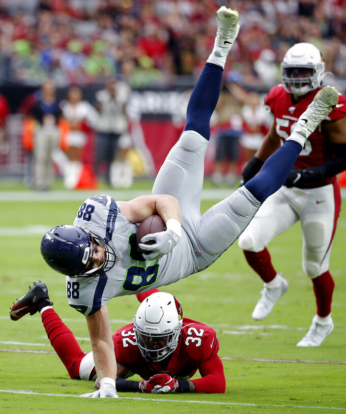 Seattle Seahawks tight end Will Dissly (88) is tackled by Arizona Cardinals strong safety Budda Baker (32) during the first half of an NFL football game, Sunday, Sept. 29, 2019, in Glendale, Ariz. (AP Photo/Rick Scuteri)