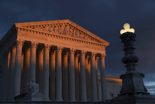 FILE - In this Jan. 24, 2019, file photo, the Supreme Court is seen at sunset in Washington. The Supreme Court is preventing the Trump administration from re-starting federal executions next week after a 16-year break. The court on Friday, Dec. 6, denied the administration's plea to undo a lower court ruling in favor of inmates who have been given execution dates. (AP Photo/J. Scott Applewhite, File)