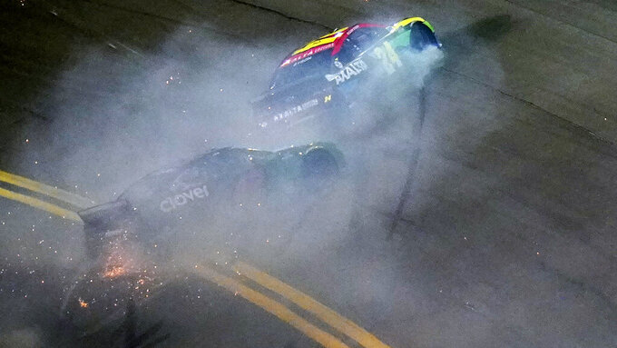 William Byron (24) and Ross Chastain (42) crash during the second NASCAR Daytona 500 duel qualifying auto race Friday, Feb. 12, 2021, at the Daytona International Speedway in Daytona Beach, Fla. (AP Photo/Chris O'Meara)
