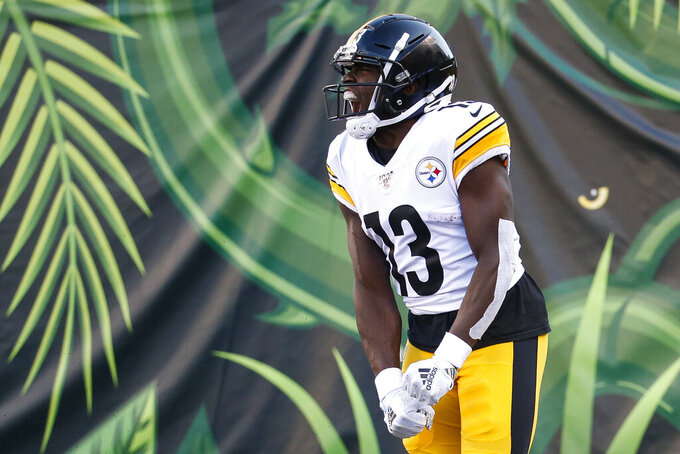 Pittsburgh Steelers wide receiver James Washington celebrates his touchdown during the second half an NFL football game against the Cincinnati Bengals, Sunday, Nov. 24, 2019, in Cincinnati. (AP Photo/Frank Victores)