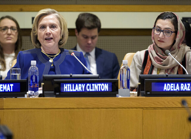 In this photo provided by the United Nations, former U.S. Secretary of State Hillary Clinton, foreground left, delivers the keynote speech at an event entitled
