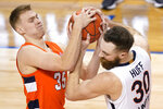 Virginia forward Jay Huff (30) battles for a rebound with Syracuse guard Buddy Boeheim (35) during the second half of an NCAA college basketball game in the quarterfinal round of the Atlantic Coast Conference tournament in Greensboro, N.C., Thursday, March 11, 2021. (AP Photo/Gerry Broome)