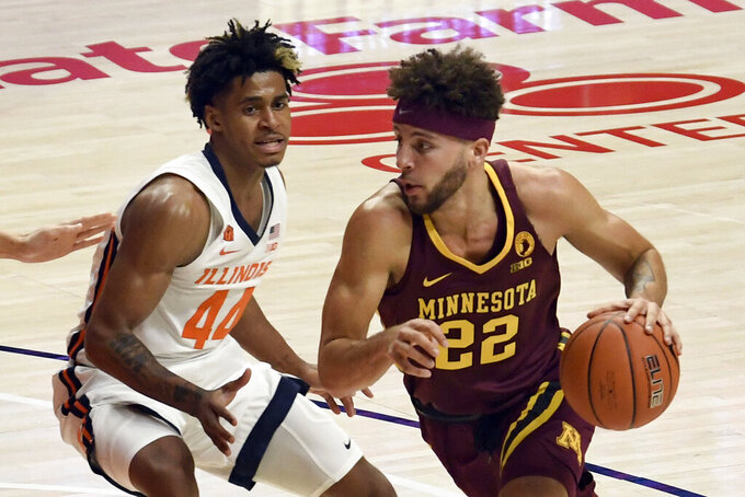 Illinois guard Adam Miller (44) pressures Minnesota's guard Gabe Kalscheur (22) in the first half of an NCAA college basketball game Tuesday, Dec. 15, 2020, in Champaign, Ill. (AP Photo/Holly Hart)