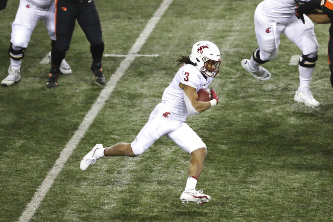 Washington State running back Deon McIntosh carries during the first half of the team's NCAA college football game against Oregon State in Corvallis, Ore., Saturday, Nov. 7, 2020. (AP Photo/Amanda Loman)