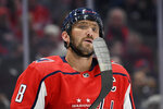 Washington Capitals left wing Alex Ovechkin, of Russia, examines his hockey stick during the first period of the team's NHL hockey game against the Los Angeles Kings, Tuesday, Feb. 4, 2020, in Washington. (AP Photo/Nick Wass)