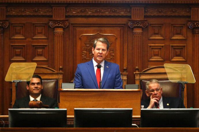 Gov. Brian Kemp, center, is flanked by House Speaker David Ralston, R-Blue Ridge, right, and Lt. Gov. Geoff Duncan as he speaks during the State of the State address before a joint session of the Georgia General Assembly Thursday, Jan. 16, 2020, in Atlanta.(AP Photo/John Bazemore)