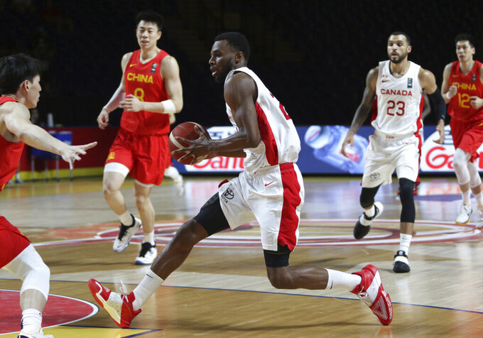 Canada's Andrew Wiggins drives against China's defense during the first half of a FIBA men's Olympic basketball qualifying game Wednesday, June 30, 2021, in Victoria, British Columbia. (Chad Hipolito/The Canadian Press via AP)