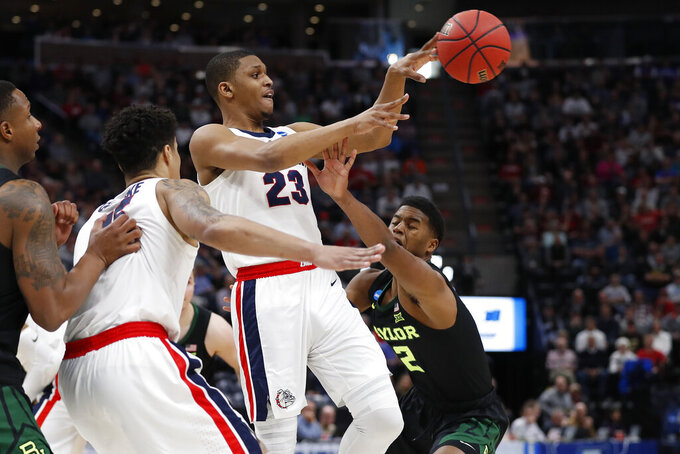 Gonzaga guard Zach Norvell Jr. (23) passes against Baylor guard Jared Butler, right, during the first half of a second-round game in the NCAA men's college basketball tournament Saturday, March 23, 2019, in Salt Lake City. (AP Photo/Jeff Swinger)