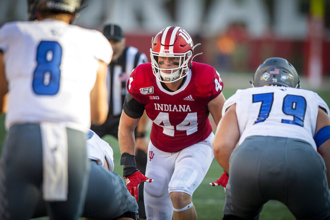 FILE - In this Sept. 7, 2019, file photo, Indiana linebacker Thomas Allen (44) prepares to rush in on Eastern Illinois quarterback Harry Woodbery (8) during an NCAA college football game in Bloomington, Ind. Under normal circumstances, you would almost have to force Indiana linebacker Thomas Allen out of his school's athletic facilities.  His recovery plan changed dramatically when the coronavirus pandemic shut down campuses and college sports. He is among many football players across the country recovering from injuries who have limited access to top-tier equipment and one-on-one help. Some experts say those issues could lengthen recovery times and put athletes at risk of re-injury. (AP Photo/Doug McSchooler, File)