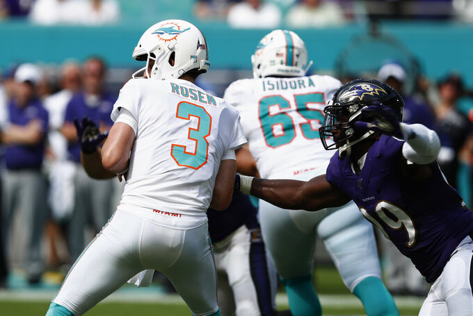 Baltimore Ravens outside linebacker Matt Judon (99) goes after Miami Dolphins quarterback Josh Rosen (3) for a sack, during the second half at an NFL football game, Sunday, Sept. 8, 2019, in Miami Gardens, Fla. (AP Photo/Brynn Anderson)
