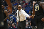 Central Florida head coach Johnny Dawkins greets his players during a time out in the first half of an NCAA college basketball game against Connecticut, Saturday, Jan. 5, 2019, in Hartford, Conn. (AP Photo/Jessica Hill)