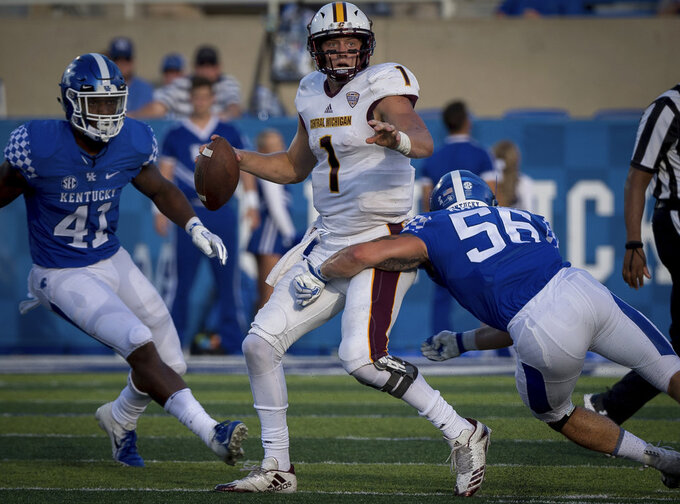 Central Michigan quarterback Tony Poljan (1) is tackled by Kentucky linebacker Kash Daniel (56) during the second half of an NCAA college football game in Lexington, Ky., Saturday, Sept. 1, 2018. (AP Photo/Bryan Woolston)