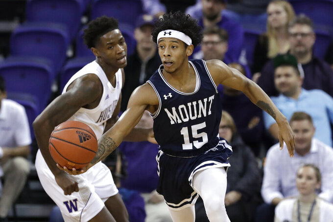 Mount St. Mary's Damian Chong Qui (15) races ahead of Washington's Nahziah Carter during the first half of an NCAA college basketball game Tuesday, Nov. 12, 2019, in Seattle. (AP Photo/Elaine Thompson)