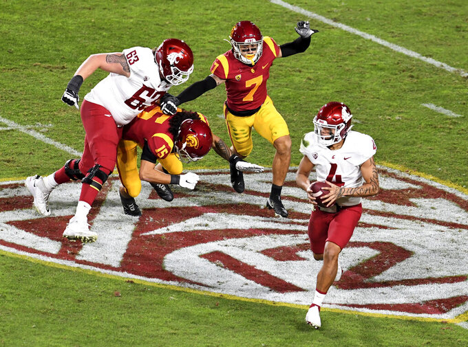 Washington State quarterback Jayden de Laura (4) scrambles against Southern California in the first half of an NCAA college football game in Los Angeles, Sunday, Dec. 6, 2020. (Keith Birmingham/The Orange County Register via AP)
