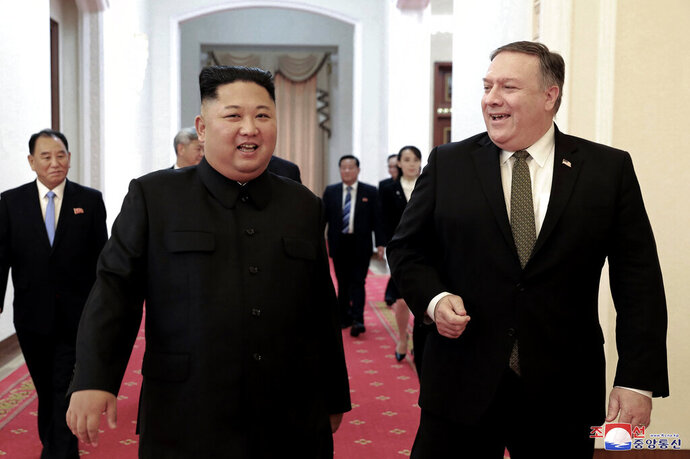 FILE - In this Oct. 7, 2018, file photo provided by the North Korean government, North Korean leader Kim Jong Un, center left, and U.S. Secretary of State Mike Pompeo walk together before their meeting in Pyongyang, North Korea. North Korea said Thursday, April 18, 2019, that it had test-fired a new type of