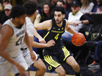 Oregon guard Ehab Amin, right, drives down the court after stealing the ball from Colorado guard Daylen Kountz, back left, as forward Evan Battey, front left, drops back to defend in the first half of an NCAA basketball game Saturday, Feb. 2, 2019, in Boulder, Colo. (AP Photo/David Zalubowski)