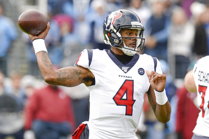 Houston Texans quarterback Deshaun Watson passes against the Tennessee Titans in the first half of an NFL football game Sunday, Dec. 15, 2019, in Nashville, Tenn. (AP Photo/Mark Zaleski)