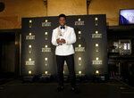 Saquon Barkley, of the New York Giants, poses with the award for AP offensive rookie of the year in the press room at the 8th annual NFL Honors at The Fox Theatre on Saturday, Feb. 2, 2019, in Atlanta. (Photo by AJ Mast/Invision for NFL/AP Images)