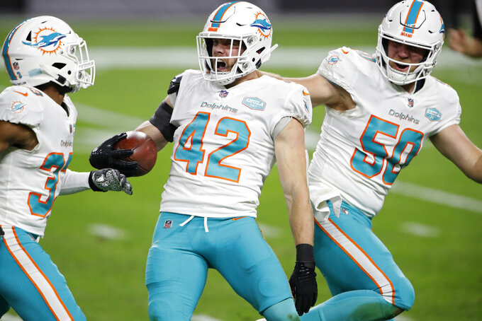 Miami Dolphins defensive back Clayton Fejedelem (42) reacts after a first-down run against the Las Vegas Raiders during the first half of an NFL football game, Saturday, Dec. 26, 2020, in Las Vegas. (AP Photo/Steve Marcus)