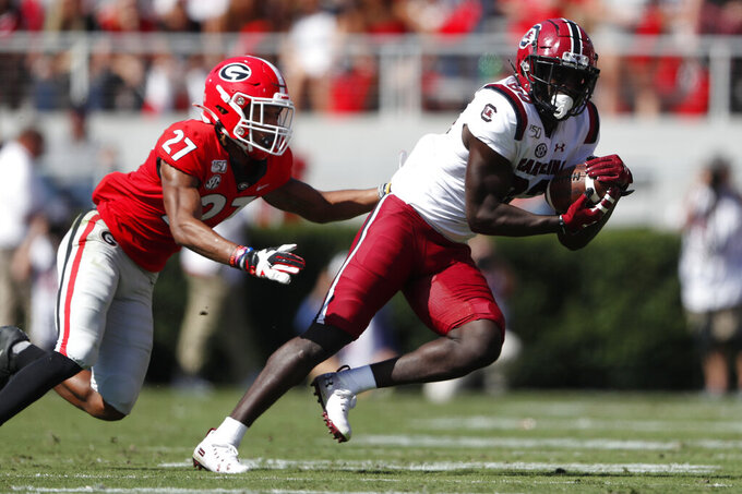 South Carolina wide receiver Bryan Edwards (89) makes a catch as Georgia defensive back Eric Stokes (27) defends in the first half of an NCAA college football game Saturday, Oct. 12, 2019, in Athens, Ga. (AP Photo/John Bazemore)