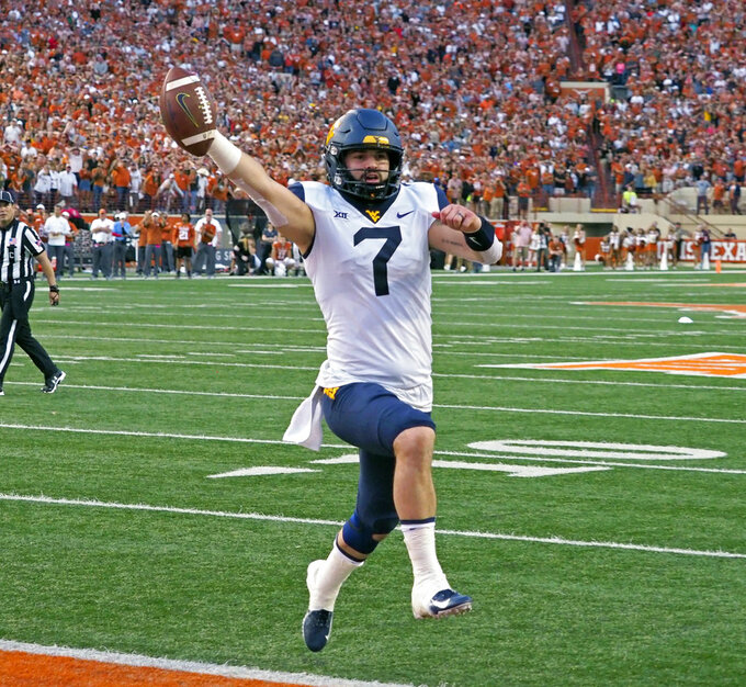 West Virginia quarterback Will Grier runs in the game winning two point conversion with 16 second to go in an NCAA college football game against Texas, Saturday, Nov. 3, 2018, in Austin, Texas. West Virginia won 42-41. (AP Photo/Michael Thomas)